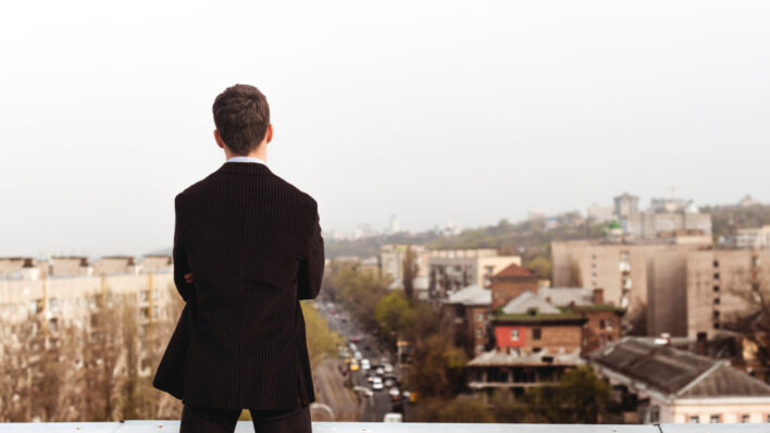 business-man-standing-roof
