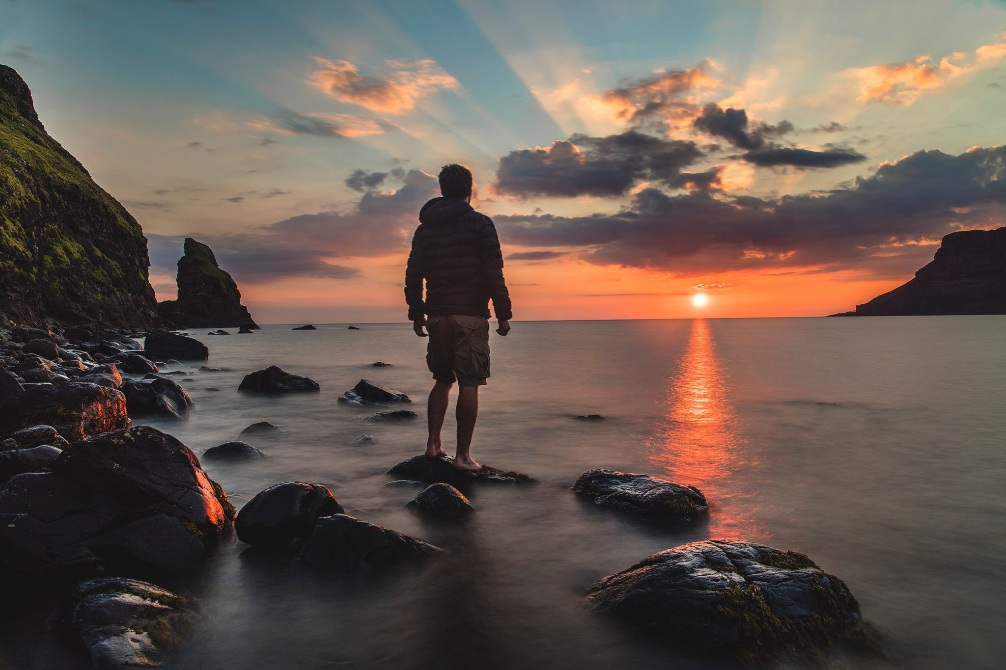 Man Standing On Rock Looking At Sunset Goalcast