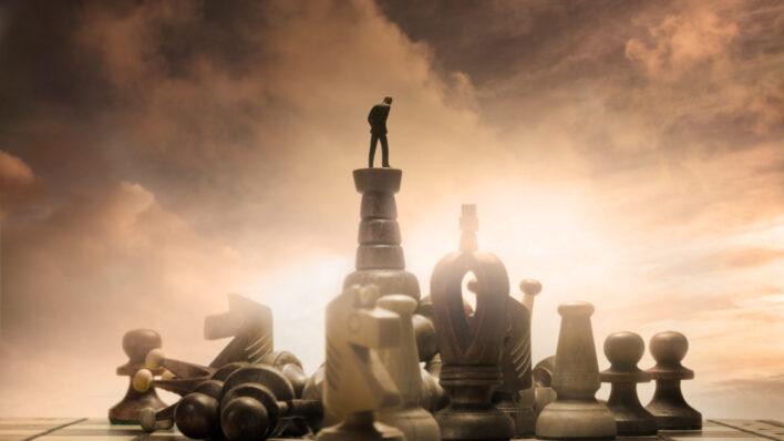 developing-resourcefulness-man-atop-chess-set