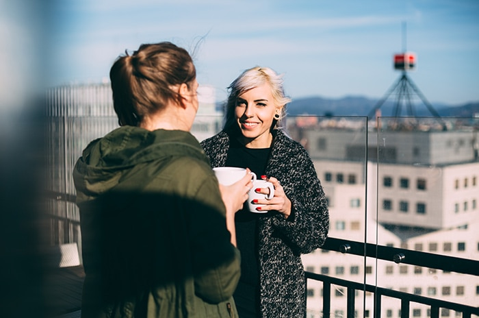 rooftop-girls-using-app-for-networking