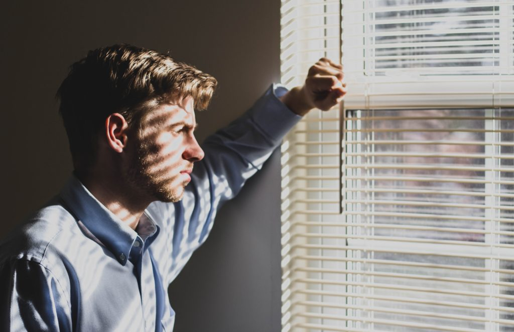sad-man-looking-out-window