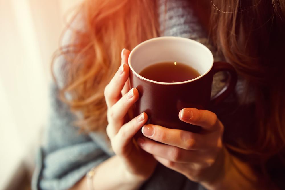 woman-drinking-hot-mug-tea