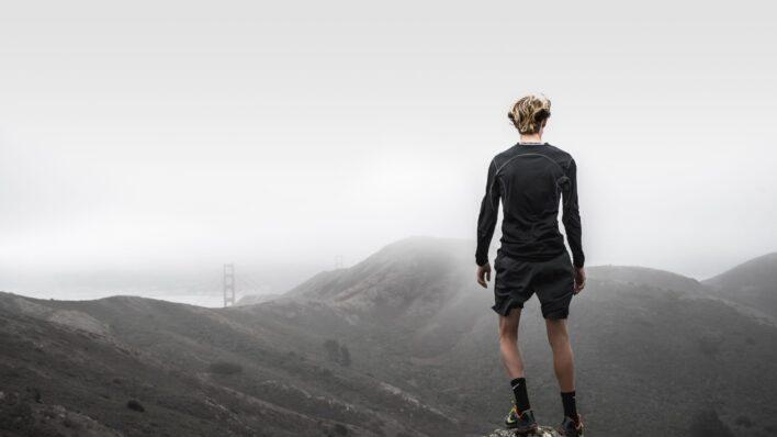man-standing-top-mountain