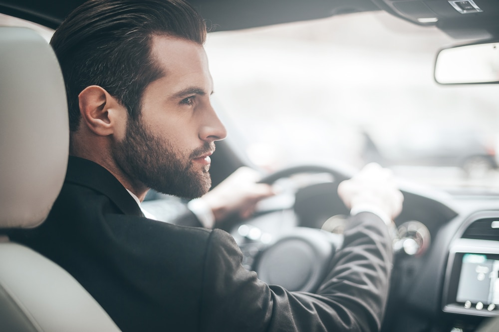 handsome-businessman-car-looking-self-aware