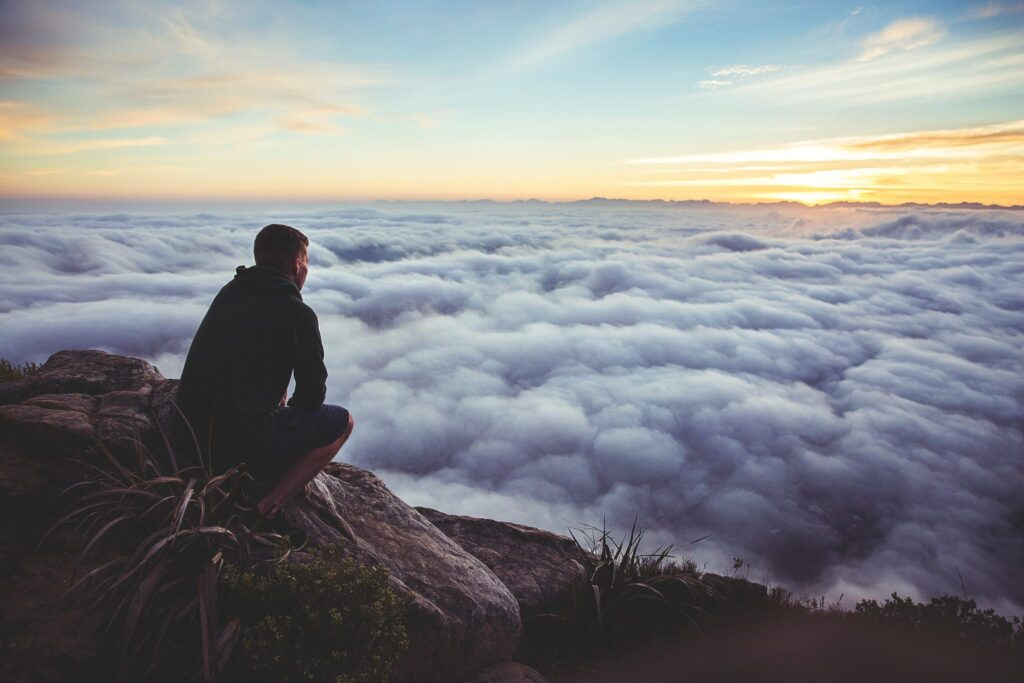 man-looking-above-clouds