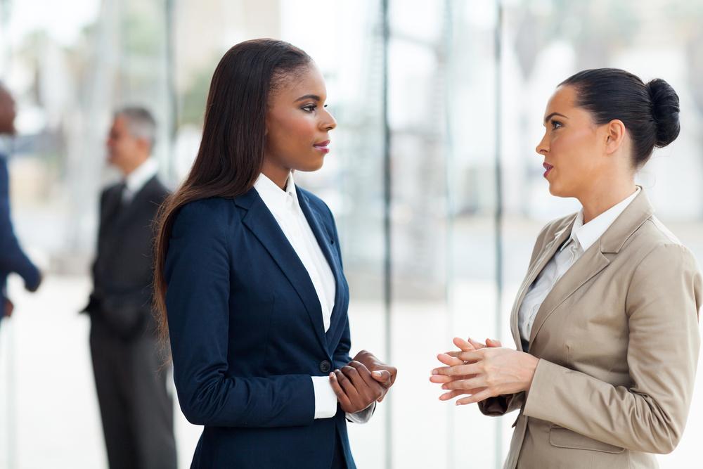 female-coworkers-tense-conversation