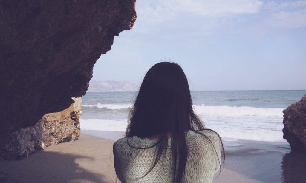 woman-looking-crashing-waves
