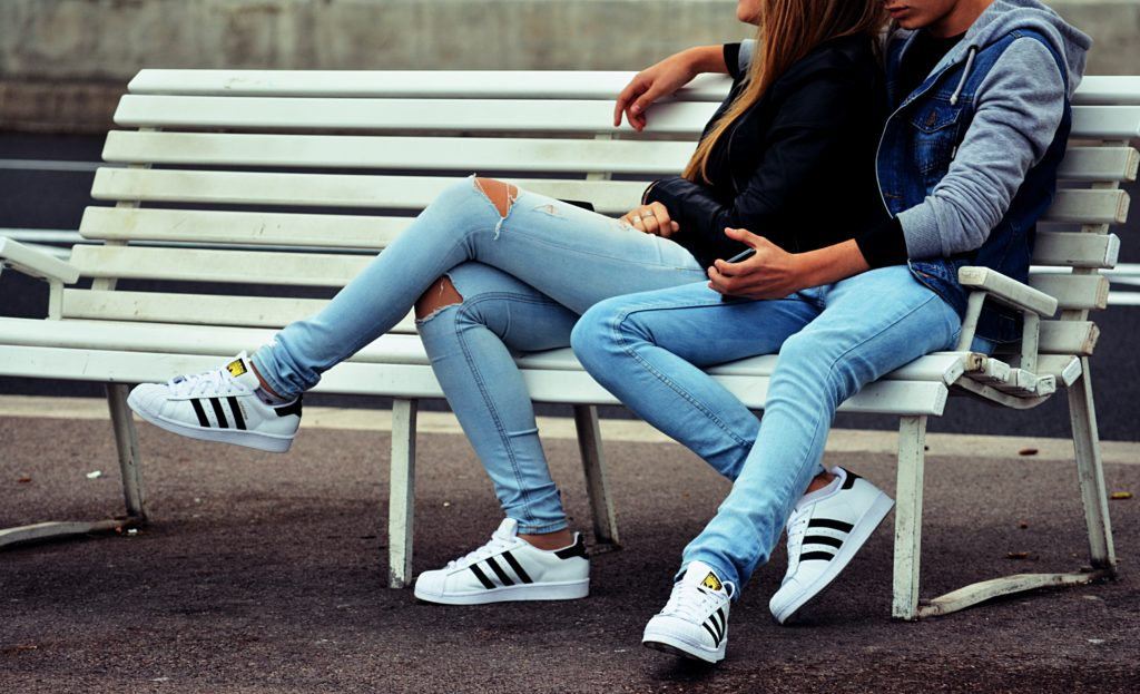 couple-wearing-jeans-bench