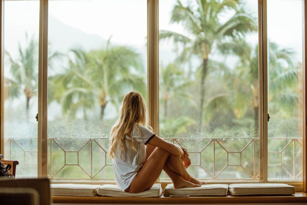 pensive-woman-looking-lush-paradise