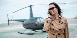 business-woman-near-private-helicopter