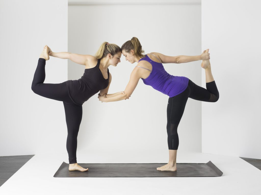 two-women-yoga-stretch