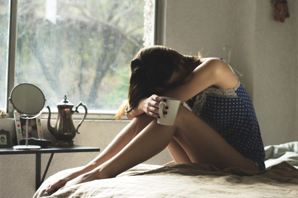 woman-feeling-despair-hugging-knees