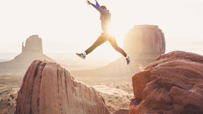 man-leaping-across-rocks