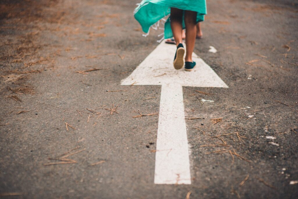 woman-walking-arrow-pointing-forward