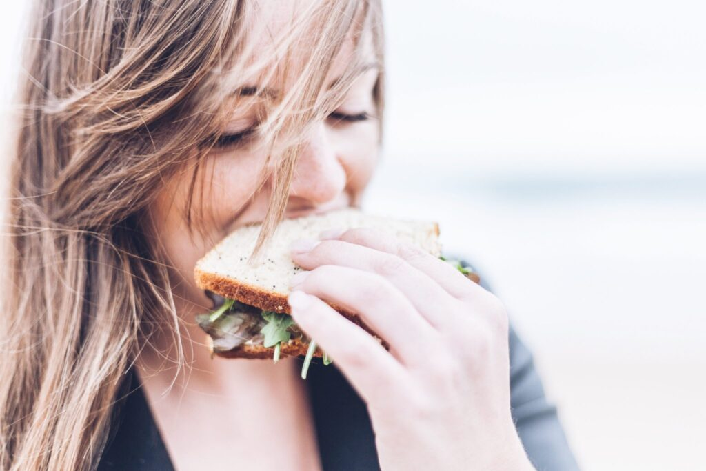 woman-biting-into-sandwich