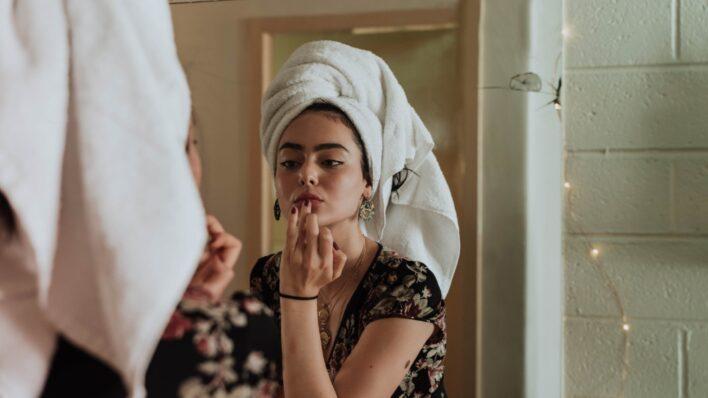 woman-looking-mirror-scrutinizing-herself