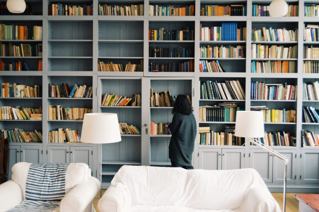 woman-looking-massive-library