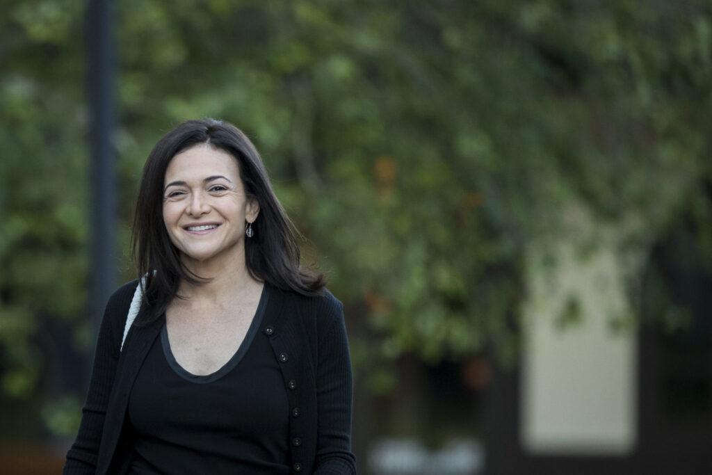 Sheryl-Sandberg-happily-walking