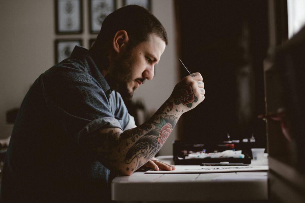 Tattooed-man-working-at-a-desk