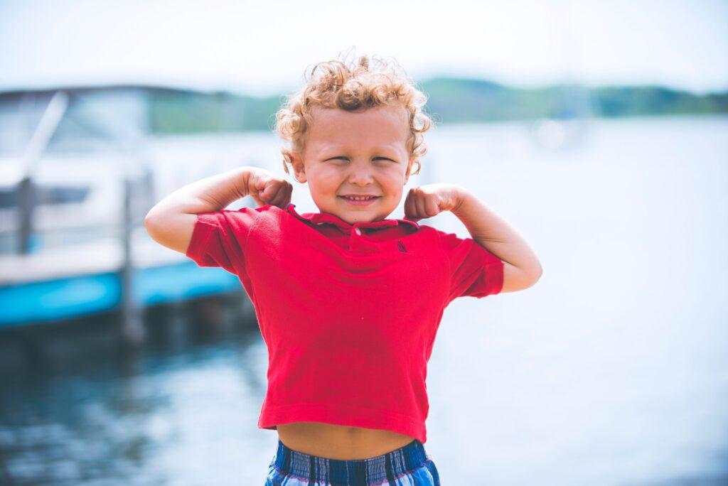 cute-blond-kid-wearing-red-shirt-smiling