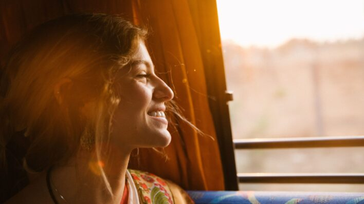 Woman-smiling-out-the-window