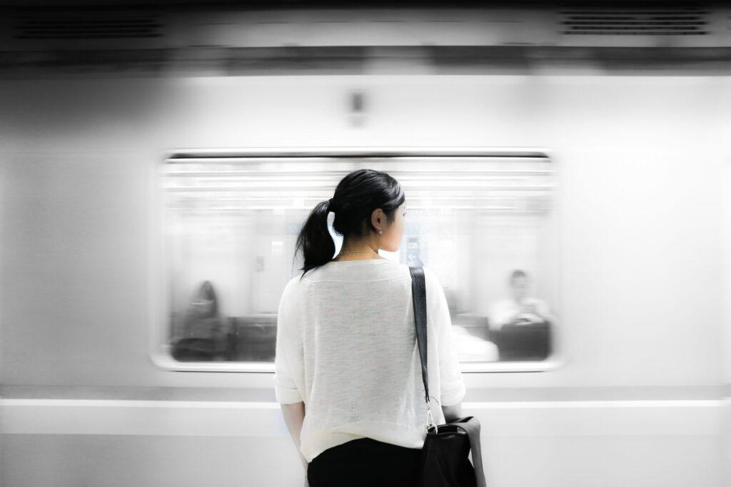 Woman-standing-on-subway-platform