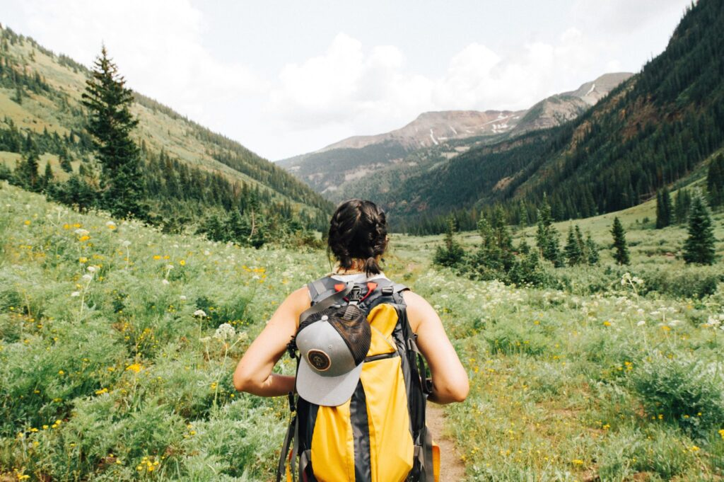 Woman-backpacking-through-wilderness