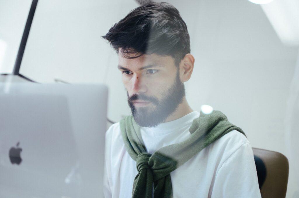 Man-working-on-a-Mac-computer