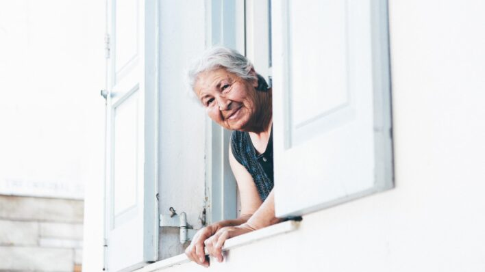 Older-woman-leaning-out the window