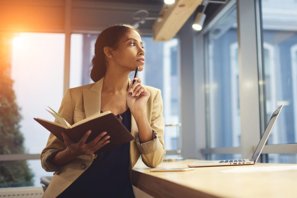 Woman-thinking-in-an-office