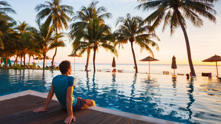 Man-relaxing-at-a-luxury-resort