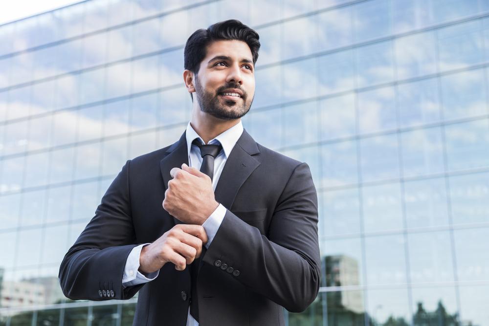 successful-businessman-adjusting-cuffs
