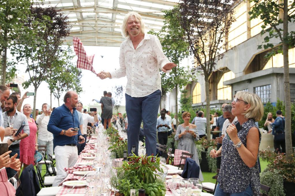 Richard-Branson-on-a-table