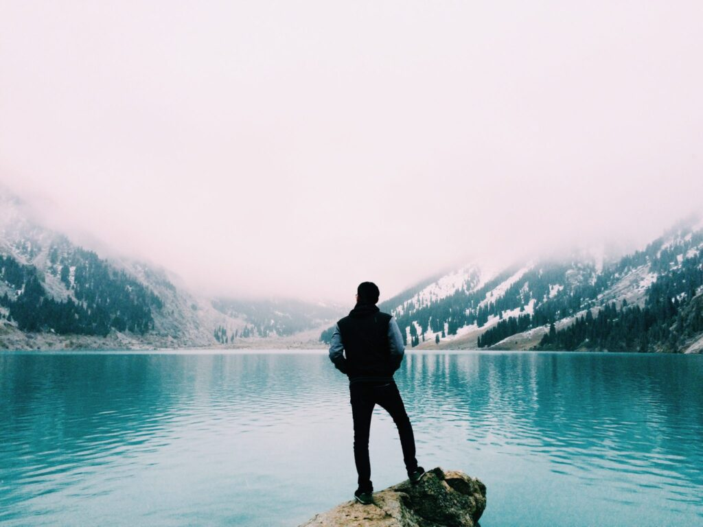 Man-standing-between-two-mountains