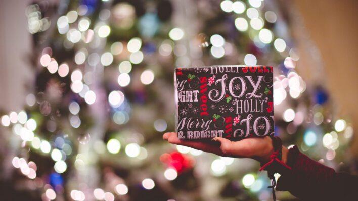 Woman-holding-a-Christmas-gift-box