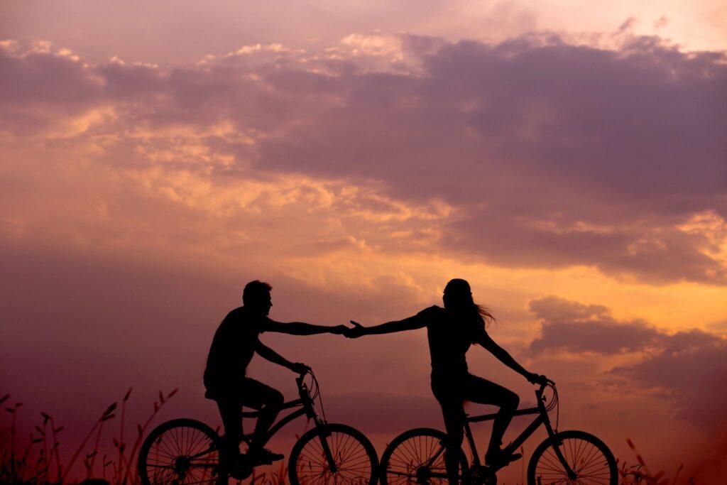 Silhouette-of-a-couple-biking
