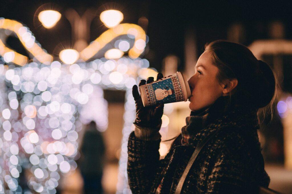 Woman-drinking-coffee-on-Christmas