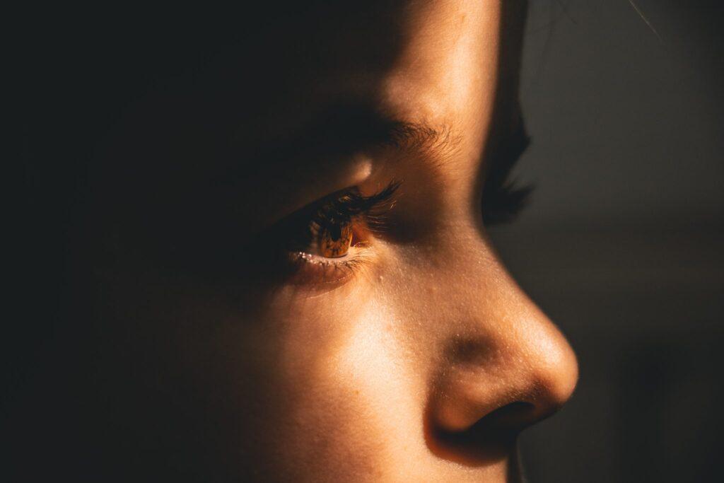 Boy-standing-in-shadow