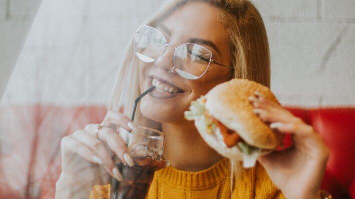 Woman-eating-a-burger