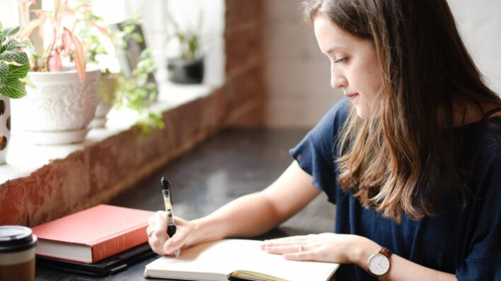 Woman-writing-in-a-notebook
