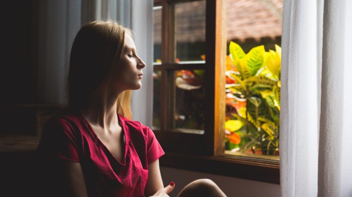 Woman-sitting-by-the-window