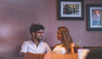 couple smiling at dinner